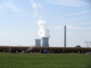 The field is on a farm next to the coal power plant.