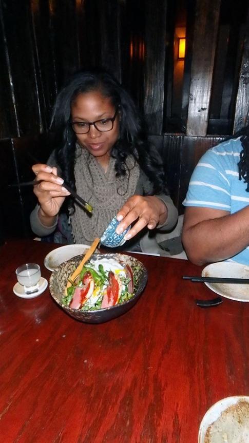 LaTonya applying the poached egg